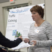A Project Advisor gives out information at the Sea Bright Community Workshop. The workshop allows residents to choose and vote on community projects that will restore Sea Bright following Superstorm Sandy. Rosanna Arias/FEMA