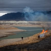 Lovelock, Nev., February 7, 2014 -- State park rangers burned weeds on the exposed lake bed of the Rye Patch Reservoir in Nevada, which was at 3.5 percent capacity amid a drought that has caused the worst water shortage the region has faced in more than a century. Photo by Max Whittaker, The New York Times