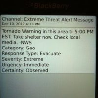 Washington, D.C., Dec. 10, 2012 -- Emergency weather alert notification on mobile phone. Alert reads, Channel: Extreme Threat Alert Message ΓÇô Dec 10, 2012 4:13PM, Tornado Warning in this area til 5:00 PM EST. Take shelter now. Check local media. ΓÇô NWS, Category: Geo, Response Type: Evacuate, Severity: Extreme, Urgency: Immediate, Certainty: Observed